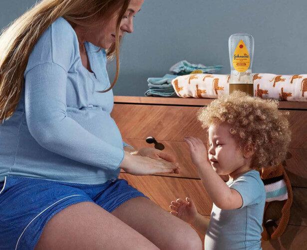 Mother and child using Johnson's® Baby Oil Gel
